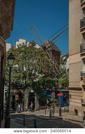 Paris, France - July 08, 2017. Old Restaurant With Windmill In A Street Of Montmartre At Paris. Know
