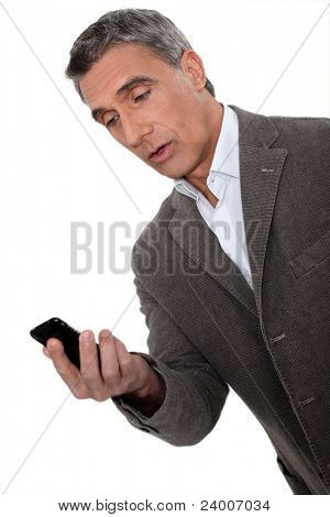 Surprised man looking at telephone