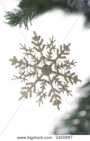 Christmas Snowflake Hanging On Fir Tree