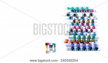 Stacks Of Antimicrobial Capsule Pills In Blister Packs. Pharmaceutical Market. Antibiotic Drug Resis