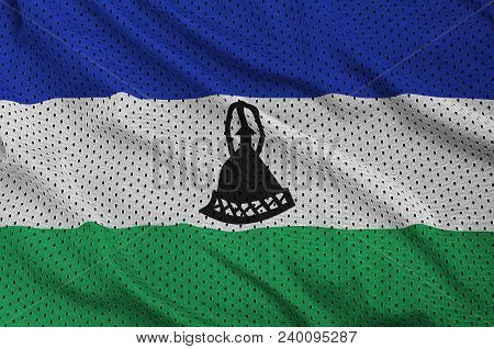Lesotho flag printed on a polyester nylon sportswear mesh fabric with some folds poster