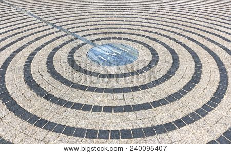 Close-up Of Pavement With Concentric Pattern. Patterned Floor Walkway Of The Large Square Of A Churc