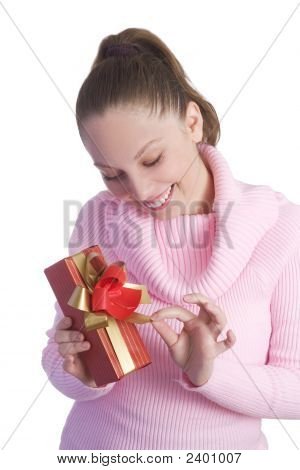 Beautiful Young Girl Holding Gift