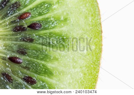 Fresh And Juicy Kiwi Fruit With Cross Section Cut In Close Up View Macro Concept To Present Kiwi Pat