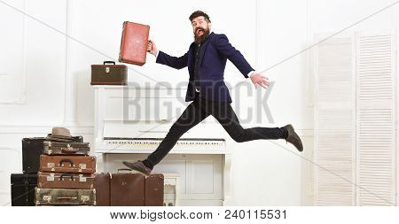 Long Awaited Vacation Concept. Macho Attractive, Elegant On Cheerful Face Carries Vintage Suitcases,