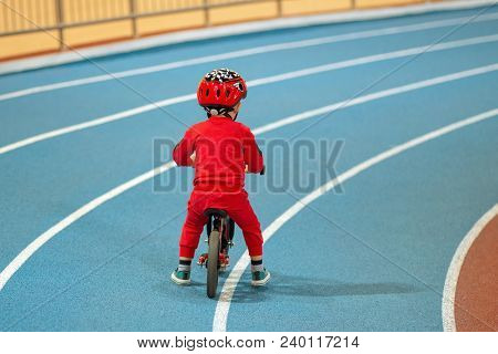 Child In Red Helmet Ride Balance Bike And Run Bike.