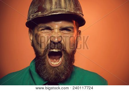 Builder In Protective Clothing And Helmet. Portrait Bearded Man With Protect Helmet. Business, Build