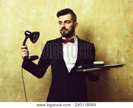 Office Manager With Neat Beard, Hairstyle, Interested Face Expression And Official Suit Holds Desk L