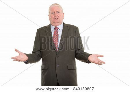 Studio Shot Of Mature Businessman Shrugging Shoulders While Looking Confused
