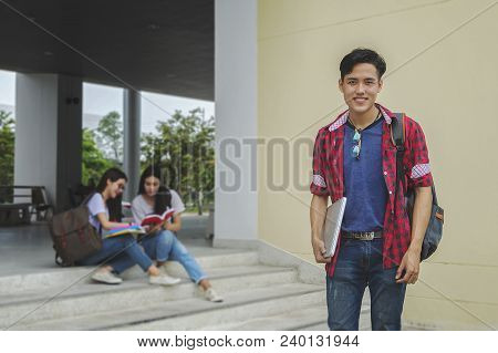 Young Asian Boy Student And Friends Are Tutoring Exam With Study Book And Laptop In Back Side, Sitti