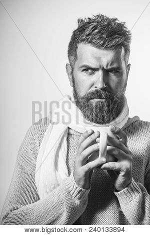 Bearded Man Warming Up With Hot Tea In Winter Time. Man With Beard, Mustache In Sweater And Scarf Ho