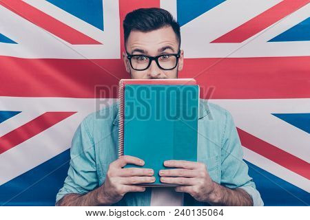 English Language Learning Concept-portrait Of Excited Man Holding Colorful Copy Book In Hands Closin