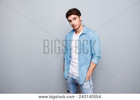 Manly, Masculine Man In Jeans Outfit, Holding Hands In Pockets Of Pants, Looking At Camera, Standing