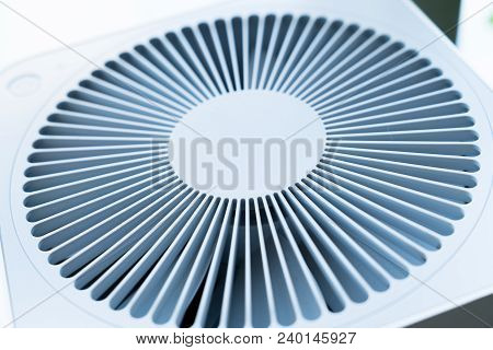 A white air purifier, radiation in the shape of outlet poster