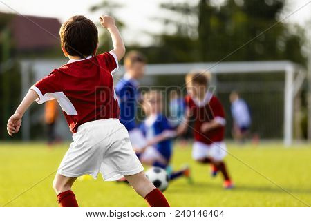 Children Playing Soccer Match. Training Football Game Between Youth Soccer Teams. Children's Soccer