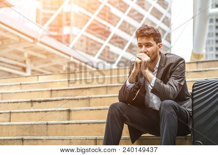 Unemployed Businessman Stress Sitting On Stair, Concept Of Business Failure And Unemployment Problem