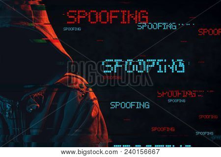 Spoofing Concept With Faceless Hooded Male Person, Low Key Red And Blue Lit Image And Digital Glitch