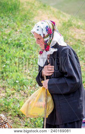 Ukraine. Khmelnitsky Region. May 2018. An Elderly Woman Feels Pain And Needs Help