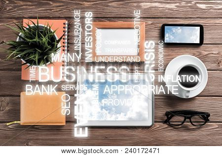 Top View Of Modern Workplace With Office Stuff And Business-related Terms Above Presenting Still Off