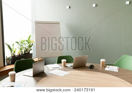 Conference Table With Laptops And Chairs In Empty Meeting Room With Nobody, Modern Company Office Bo