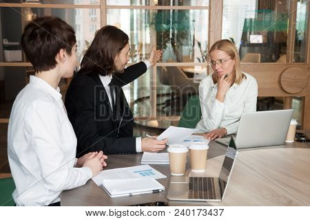 Rude Angry Businessman Firing Upset Frustrated Businesswoman Telling To Leave Meeting, Humiliation A