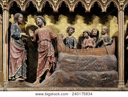 PARIS, FRANCE - JANUARY 04, 2018: Intricately carved and painted frieze inside Notre Dame Cathedral depicting Appearance to the Apostles by the Lake Tiberias, UNESCO World Heritage Site in Paris.