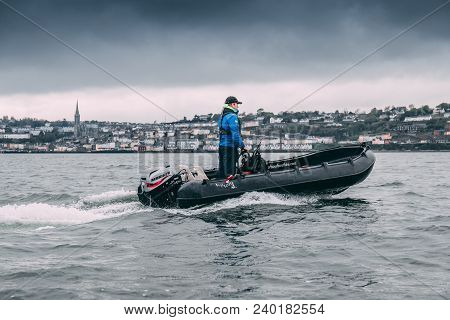 May 7th, 2018, Cobh, County Cork, Ireland - A Man Standing On A Cork Harbour Boat Hire Boat, A Compa