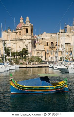 Traditional Colorful Maltese Fishing Boat In Harbor Of Malta