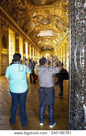 Paris, France - July 14, 2013: Tourists Visit Art Gallery In The Louvre Museum. The Louvre Museum Is