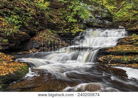 Whitewater Splases Down A Cascading Waterfall In Ganoga Glen At Ricketts Glen State Park, Pennsylvan