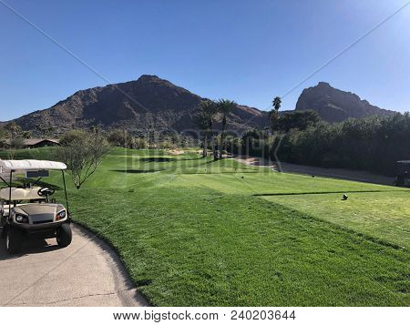 Camelback Mountain in Phoenix, Scottsdale, Az, surrounded by luxury homes and golf courses.