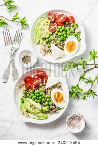 Savory  Breakfast Grain Bowl. Balanced Buddha Bowl With Quinoa, Egg, Avocado, Tomato, Green Pea On L