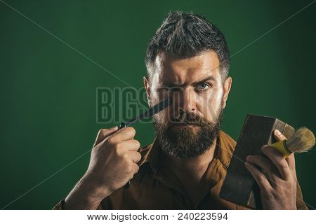 Bearded Man With Long Beard, Brutal Caucasian Hipster With Beard And Moustache, Holds In The Hands D