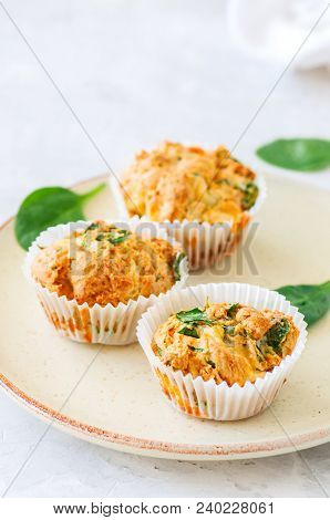 Savory Potato Spinach And Feta Muffins Served On A Plate. White Stone Background.