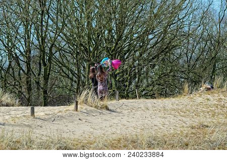 Two Young Women With Helium Ballons On A Sandy Dune. Nature Reserve Boberger Niederung In Hamburg, G