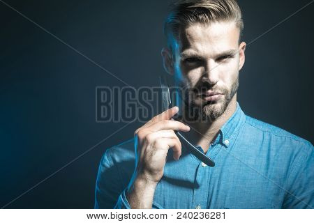 Handsome Bearded Hairdresser In Stylish Clothes Holding A Dangerous Razor. Handsome Bearded Man, Hip