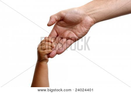Baby boy holds the hand of his father