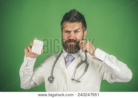 Healthcare, Prevention, Treatment Concept - Physician With Beard And Stethoscope On Neck In White Co