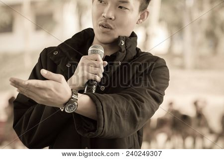 Seminar Conference Concept: Smart Businessman Speech And Speaking With Microphones In Seminar Room O
