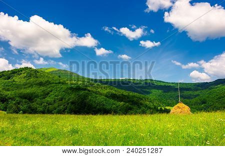 Haystack On A Grassy Pasture In Mountains. Beautiful Summer Scenery On A Fine Weather Day