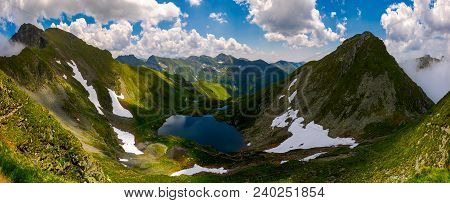 Panorama Of Fagaras Mountains Of Romania. Gorgeous Landscape With Glacier Lake Capra, View From Abov