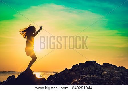 Silhouette Of Young Woman Relax Pose Or Freedom Pose Or Chill Pose And Standing At  On The Beach Dur