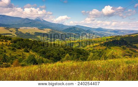 Autumnal Countryside Of Carpathian Mountains. Forested Hills And Magnificent Pikui Peak Of Carpathia