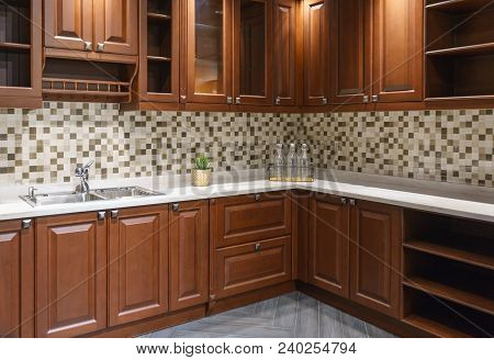 Contemporary Upscale Home Kitchen Interior With Wood Cabinets And Floors, Granite Countertop, Accent