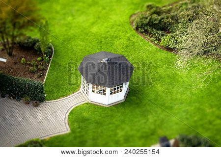 Small Pavillon In A Garden On A Green Lawn In The Spring Seen From Above