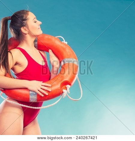 Lifeguard With Ring Buoy Lifebuoy. Woman Girl Supervising Swimming Pool Water On Blue. Accident Prev