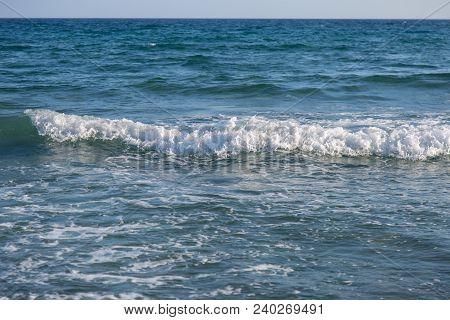 Waves Near The Shoreline: Summer Vacation Concept.