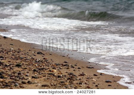 Waves And Stones On The Beach