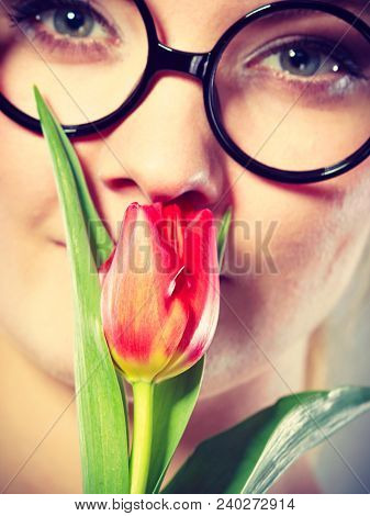 Peace And Content. Beauty Adorable Girl Smelling Beautiful Spring Flower. Peaceful Enjoyable Woman W