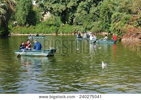 BARCELONA, SPAIN - NOVEMBER 1, 2017: People enjoy the boating lake in the Parc de Ciutadella. The largest park in the City, it was the site of the 1888 World Exposition.